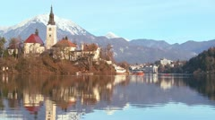 Stock Video Footage of The reflection of a church steeple in the waters of Lake Bled, Slovenia.