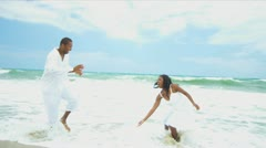 African American father spending time on the beach with daughter   - stock footage