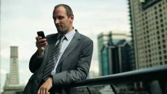 Young handsome businessman with smartphone in the city HD - stock footage