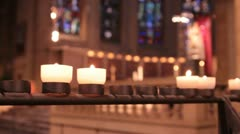Tracking Shot of Candles Burning Inside Beautiful Church Stock Footage