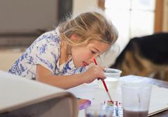 Caucasian girl painting Stock Photos