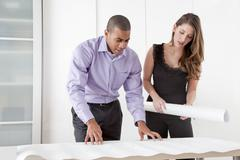 Architects looking at blueprints Stock Photos