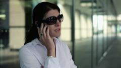 Angry young businesswoman talking on cellphone in the city HD - stock footage