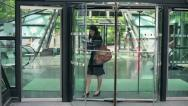 Young businesswoman talking on cellphone in the city, slow motion HD Stock Footage