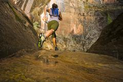 Persian woman running in a remote area - stock photo