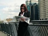 Young businesswoman working with documents in the city NTSC Stock Footage