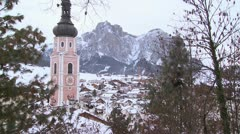 Church steeple in a snowbound Tyrolean village in the Alps in Austria, - stock footage