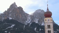 Time lapse clouds over an Eastern church in a snowbound Tyrolean village in the Stock Footage