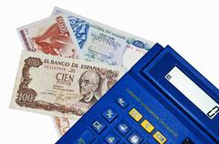 euro-crisis,calculator with peseta and drachm banknotes - stock photo