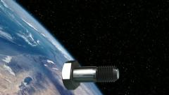 Screw (debris) floating in space in orbit around Earth - stock footage