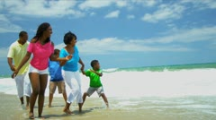 Summer holiday of ethnic happy family enjoying together beach   - stock footage