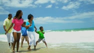 Summer holiday of ethnic happy family enjoying together beach   Stock Footage