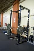 squat rack at a gym - stock photo