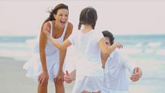 Caucasian family spending summer vacation together on beach   - stock footage