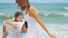 Happy Caucasian parents daughter enjoying holiday together walking on beach   - stock footage