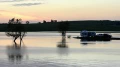Campers watching the sunset from their RV at Far West Reservoir near Spenceville - stock footage