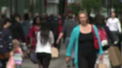 Unrecognisable crowd of different races and nationalities in city Stock Footage