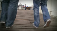 Two males walks on deck Stock Footage