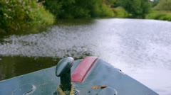 Canal Boat slowly Moving through English Landscape - Front view. Stock Footage