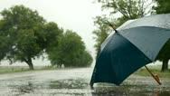 Umbrella On The Road Under Rain Stock Footage