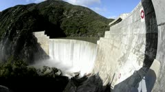 Wide angle shot of Matilija Creek spilling over the obsolete Matilija Dam after - stock footage