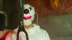 clown castration evil demonic serial killer - stock footage