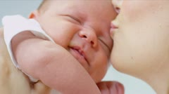 Loving Mother Kissing Baby Daughter Stock Footage