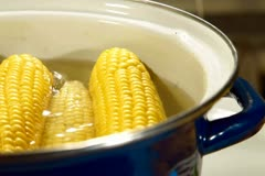 DOLLY: Corn Cob Boiling in a Pot Stock Footage