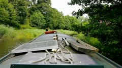 Canal boat slowly moving through English Landscape. Stock Footage