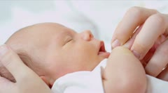 Newborn Baby Held by Young Mother - stock footage