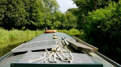 Canal boat slowly moving through English Landscape v2 Stock Footage