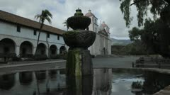 Time lapse dolly shot of the Mission Santa Barbara reflecting in the front Stock Footage