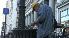 Homeless Eats By The Garbage Can Stock Footage
