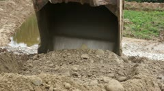 Close-up of an Excavator Bucket Digging in the Dirt - stock footage