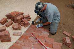 Homeowner Constructs Brick Path Stock Photos