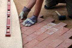 Man Lays Brick Pavers - stock photo