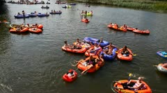 Inflatable boats in a river Stock Footage