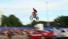 MC jumping over 7 cars Stock Footage
