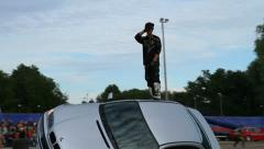 Stunt man on car driving on two wheels Stock Footage