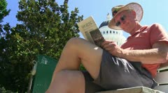 Man reading newspaper,  sports page Stock Footage