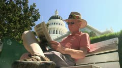 Man reading newspaper, Capitol Stock Footage