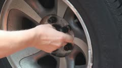 Removing screws from the car wheel Stock Footage