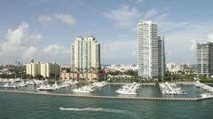 Wide shot Miami Florida high rise apartments from the POV from a cruise ship. - stock footage