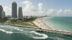 Wide shot Miami Florida extremely crowded baches from the POV from a cruise - stock footage