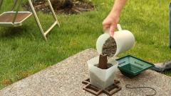 Filling a Bird Feeder - stock footage