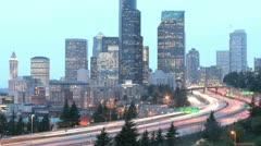 As the golden-hour darkens into night, accelerated traffic blurs into streaks of - stock footage