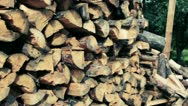 Stacked firewood flyby shot Stock Footage