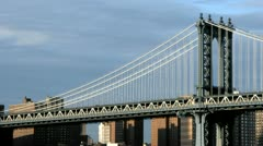 Accelerated traffic zips across the Manhattan Bridge beneath a darkening cloudy Stock Footage