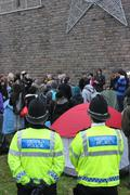 Welsh police watch Occupy protest. - stock photo