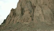 Shadows and sunlight alternate as clouds pass over New Mexico's Shiprock. Stock Footage
